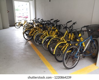 Ofo yellow sharing bikes under HDB flats in Singapore during the day, 8th August 2018.