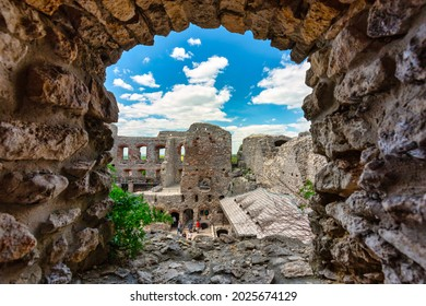 Ogrodzieniec, Poland - June 2, 2021: The beautiful architecture of the ruins of the Ogrodzieniec castle with tourists visiting the historic building, Poland.