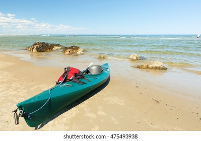 """Ogunquit, Maine - August 27, 2016: A Green Kayak Docking on the Ogunquit Beach, Maine. Ogunquit was named by the Abenaki tribe, because the word means """"beautiful place by the sea"""""""