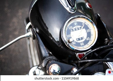Ogunquit, Maine, USA: June 2, 2018: A closeup shot of a BMW R69S vintage motorcycle's speedometer as it sits mounted to the headlight.  A BMW R69S motorcycle is considered to be a collectible item.