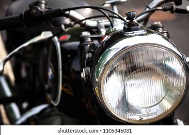 Ogunquit, Maine, USA: June 2, 2018: A shallow focus shot of the front headlight of a vintage BMW R69S motorcycle.  The BMW R69S motorcycle is a rare antique.