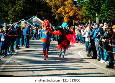 Ogunquit, Maine USA: October 21st, 2018: Two participants compete in the Ogunquit High Heel Dash in support of the Frannie Peabody Center.