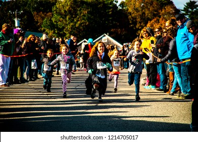 Ogunquit, Maine USA: October 21st 2018: young kids compete in the Ogunquit High Heel Dash to benefit the Frannie Peabody Center.