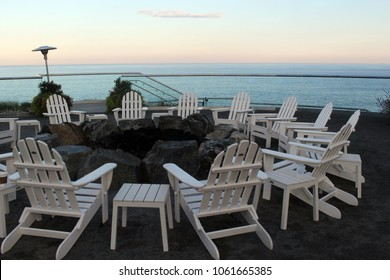 Ogunquit,  Maine / USA; September 09, 2017; Comfortable seating and a fire pit overlooking the ocean at sunset in Ogunquit, Maine.
