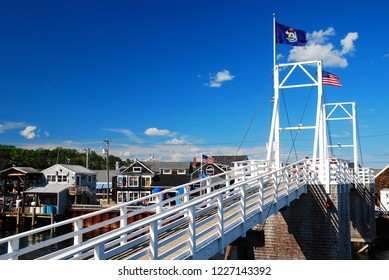 Ogunquit, ME, USA August 12, 2013 A pedestrian drawbridge, flying the state flag of Maine, spans Perkins Cove in Ogunquit Maine