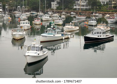 Ogunquit, ME, USA - July 24, 2020: Fishing and recreational boats at the basin in Perkins Cove