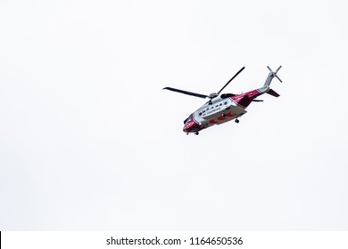 OGWEN GLEN / WALES - APRIL 29 2018 : British HM Coastguard helicopter Sikorsky S-92 operated by Bristow Helicopters conducting a rescue exercise at Ogwen Glen.