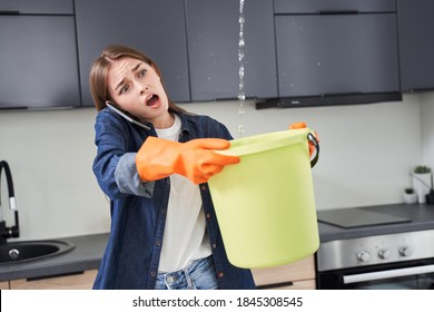 Oh my god! Trouble! Upset housewife calling roof repair service while water leaking from ceiling. Woman trying to collecting water at the bucket