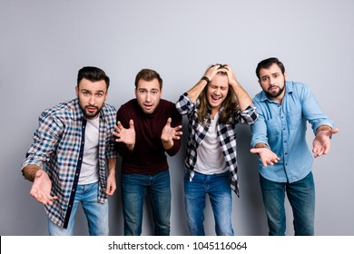 Oh no! Frustrated surprised shocked troubled upset buddies grimacing gesturing and watching soccer world cup, wearing denim checkered shirt turtleneck isolated on gray background