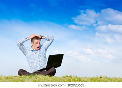 Oh. No! man with laptop working outdoor