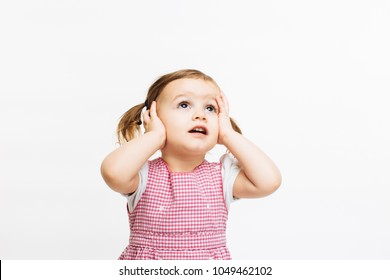 Oh no - Preschool toddler girl holding her head and looking up, isolated on white background