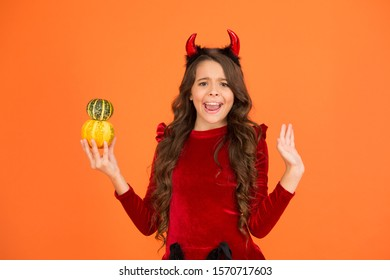 Oh no. Unhappy child hold pumpkins orange background. Little child with unhappy look make magic tricks. Unhappy failure. Unhappy Halloween.