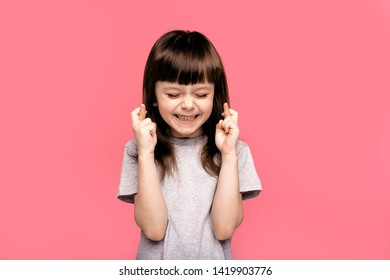 Oh please, I want to buy it. Little pretty cute kid girl asks her parents to buy her new modern toys. Pray and having hope. Happy joy fun enjoy emotional concept.
