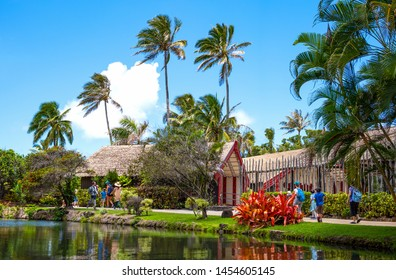 Ohahu island, Hawaii - Aptil 30, 2019: Tourists walking between  the irrepressible nature of the Polynesian center in the north east area of the island