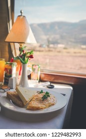 The ohm eggs and toasts placed on a plate, which is one dish of breakfast  on the Peru Titicaca Train for passengers.