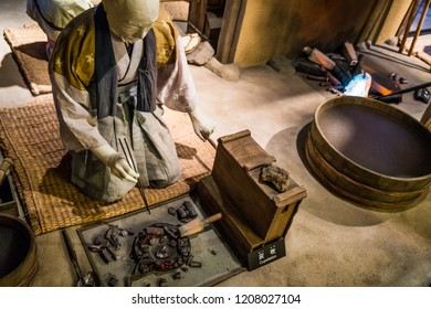 OHMORI, SHIMANE, JAPAN - AUGUST 29, 2018: A display at the Iwami Ginzan World Heritage Center museum shows historic cuppleation, or haifuki, a process used to obtain silver from mined ore