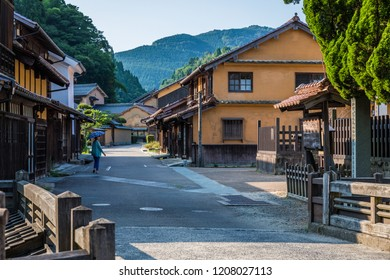 OHMORI, SHIMANE, JAPAN - AUGUST 29, 2018: A woman walks down the main road of the residential area of Iwami Silver Mine, full of historic buildings, cafes, and museums—now a World Heritage Site