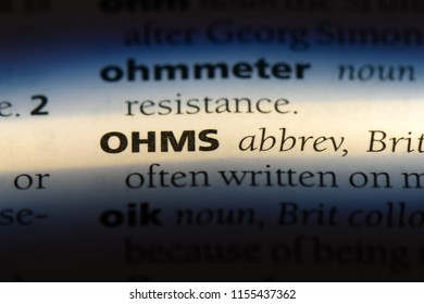ohms word in a dictionary. ohms concept.