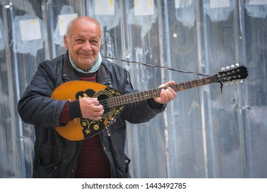 Ohrid, Northern Macedonia -  April 2019 : Street busker playing guitar in Ohrid town