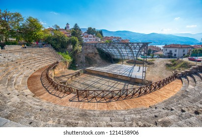 Ohrid, Republic of Macedonia - 16 October, 2018: The antique ancient greek amphitheater. Theatre of Ohrid with view on old town and Lake Ohrid. UNESCO natural and cultural heritage sites.