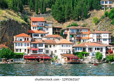 Ohrid, Republic of North Macedonia (ex-FYROM) / 08 20 2014 : Old houses and terraces along the lake of Ohrid, City of Ohrid, Republic of North Macedonia