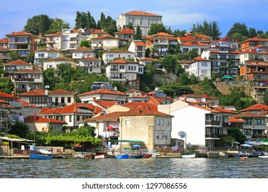 Ohrid, Republic of North Macedonia (ex-FYROM) / 08-20-2014 :  Old houses and terraces along the lake of Ohrid, City of Ohrid, Republic of North Macedonia