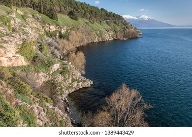 Ohrid/North Macedonia - March 28,2018: The shoreline of lake Ohrid in North Macedonia with snowcapped mountains in the background.
