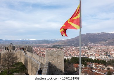 Ohrid/North Macedonia - March 29,2018: The walls of Samuals Fortress in Ohrid, North Macedonia with the Macedonian flag and Ohrid town in the background.