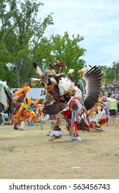 Ohsweken, Ontario, Canada - July 24, 2016 : Six Nations of the Grand River Pow Wow.  Turtle Island. Grass Dancers, Fancy Feather Dancers Powwow Native American in their traditional regalia.