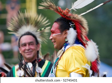 OHSWEKEN, ONTARIO, CANADA - JULY 27: Traditional dancers waiting for their dance to start during the Grand River Champion of Champions Powwow July 27, 2008 in Ohsweken, Ontario, Canada.