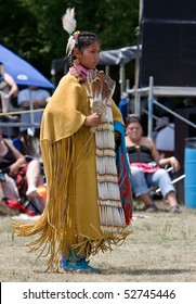 OHSWEKEN, ONTARIO, CANADA - JULY 27: A young Traditional or Buckskin Dancer performs during the Grand River Champion of Champions Powwow July 27, 2008 in Ohsweken, Ontario, Canada.