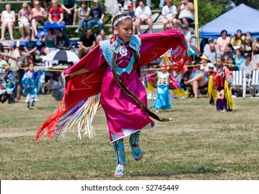 OHSWEKEN, ONTARIO, CANADA - JULY 27:  A young Shawl Dancer performs at the Grand River Champion of Champions Powwow July 27, 2008 in Ohsweken, Ontario, Canada. The dance symbolizes a butterfly's life.