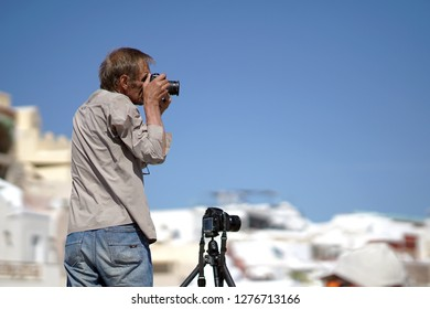 OIA, GREECE, 19 September 2018 Stock photographer takes photografies of the landscapes of Santorini, Cyclades