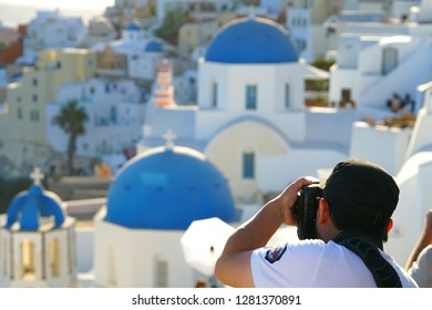 OIA, GREECE, 19 September 2018 Tourist takes photografies of the landscapes of Santorini, Cyclades