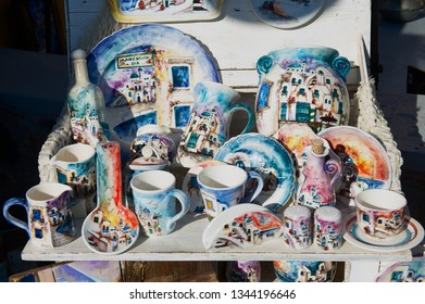 Oia, Greece - August 02, 2012: Traditional handmade souvenirs from Santorini island at a stall of a street souvenir shop in Oia, Greece.