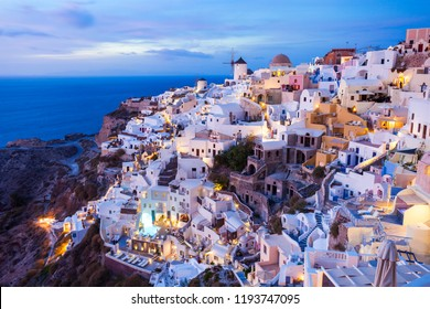 Oia on sunset. Oia or Ia is a small town in the South Aegean on the islands of Santorini in the Cyclades, Greece