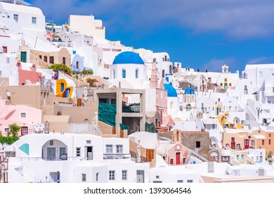OIA, SANTORINI - APRIL 10, 2019: Oia is a popular tourist coastal town on Greek Aegean island Santorini famous for it's whitewashed houses carved into the rugged clifftops
