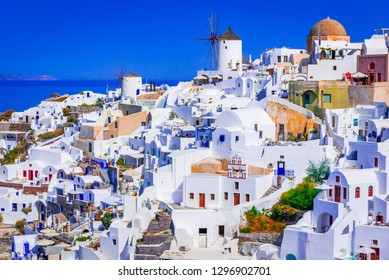 Oia, Santorini, famous whitewashed village with cobbled streets, windmills, Greek Islands, Greece.