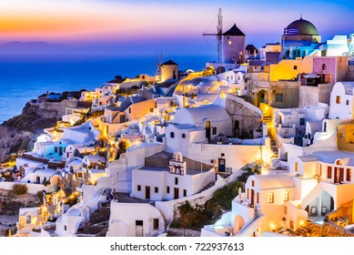 Oia, Santorini - Greece. Idyllic attraction of white village with cobbled streets and windmills, Greek Islands of Cyclades.