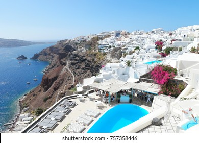 Oia Santorini Greece September 2017, People relax by the swimming pool of luxury resort Canaves Oia