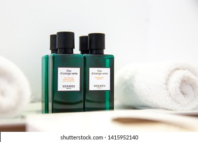 Oia, Santorini/Greece - May 2019: Four small bottles of Hermes Eau d'Orange Verte shampoo, lotion, conditioner and body gel in the vanity area of hotel Canaves Oia in Santorini, Greece.