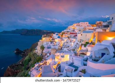 Oia town cityscape at Santorini island in Greece at sunset. Aegean sea