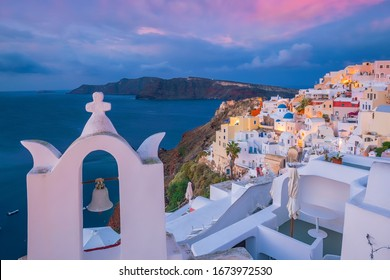 Oia town cityscape at Santorini island in Greece at sunset. Aegean sea
