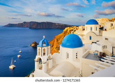 Oia town on Santorini island, Greece with traditional buildings with blue domes