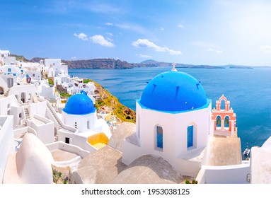 Oia town on Santorini island, Greece. Traditional and famous houses and churches with blue domes over the Caldera, Aegean sea