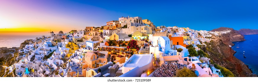 Oia town, Santorini island, Greece: Panoramic view at the sunset. Traditional and famous white houses and churches  with blue domes over the Caldera, Aegean sea.