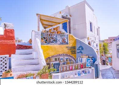 OIA VILLAGE, SANTORINI ISLAND, GREECE - August 06, 2018: Atlantis Bookshop - Old Book store on street of Oia village in Santorini Island, Greece.