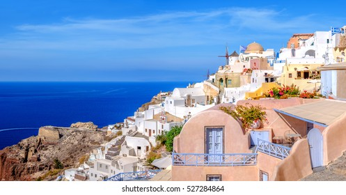 Oia village, Santorini island, Greece, on a bright day, panoramic image