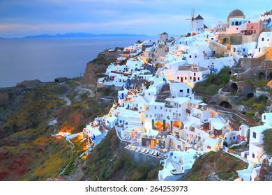 Oia village with traditional white buildings after sunset, Santorini island, Greece