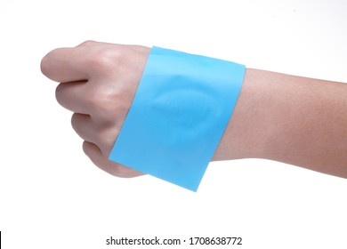 oil absorbing film on the back of the hand.